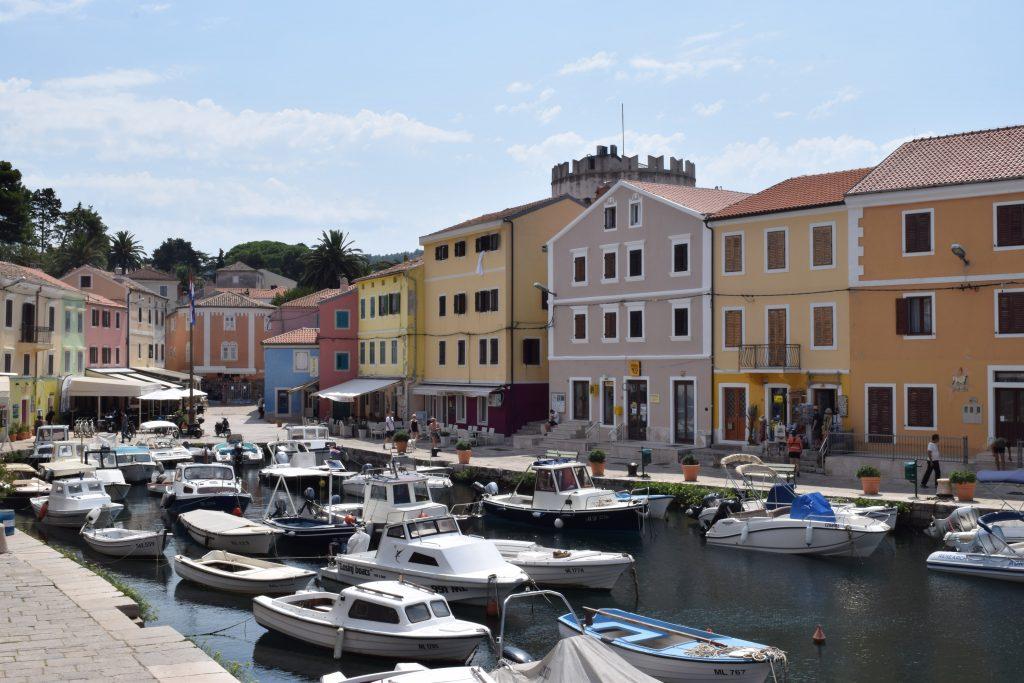 Colorful houses in Veli Losinj - must visit on Croatia van trip