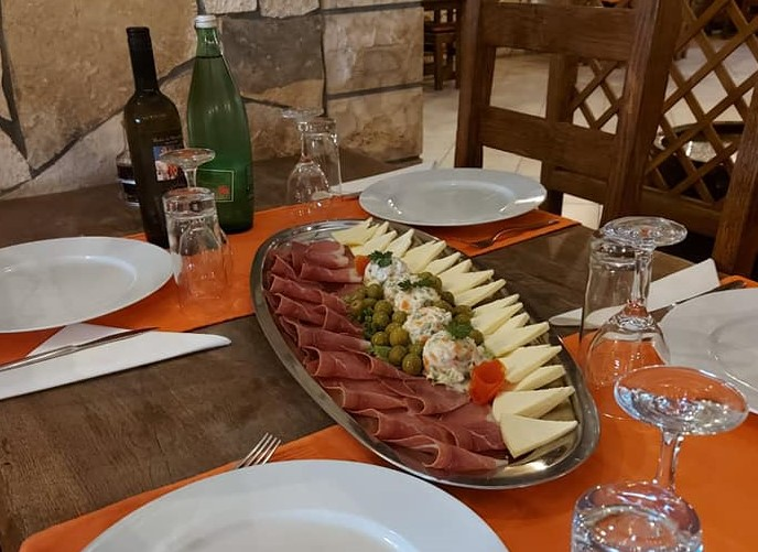 While on van holiday in Croatia, must start your meal with local appetizer like prsut and cheese.